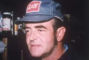 Permon Gilbert, wearing a denim baseball cap