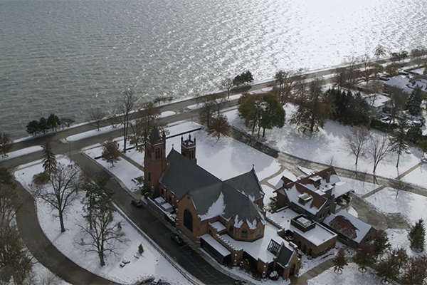 Aerial of church and lake, snow