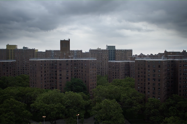 MLK towers with a gray sky above