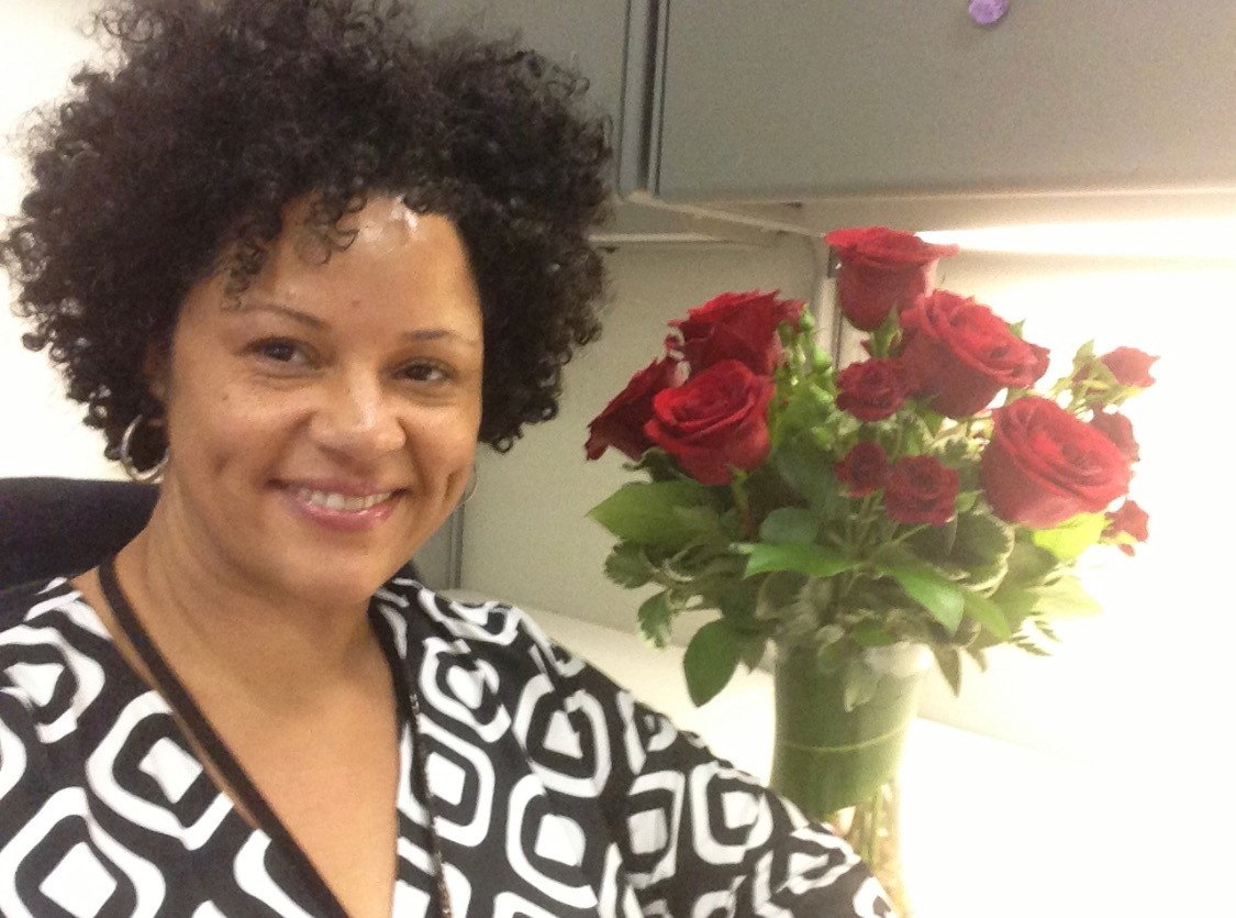 Alicia Griffin, smiling with roses