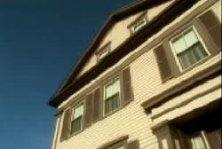 A three story house, light yellow.