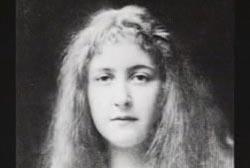 A black and white headshot of Agatha Christie