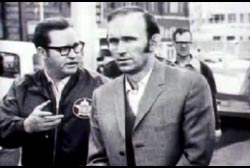 Richard McCoy walking next to a police officer.