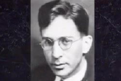 Headshot of Dr. Carl Austin Weiss, he is wearing wire rimmed glasses