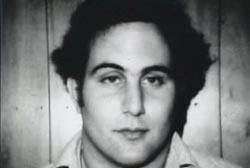 David Berkowitz standing infront of a wood paneled wall.