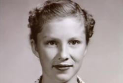 A young woman with her hair up in braids.