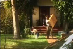 A family is moving their belongings out of a surburban house.