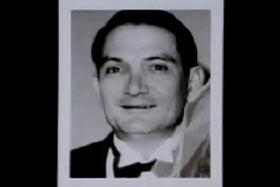 A caucasian man with brown hair in a tuxedo.