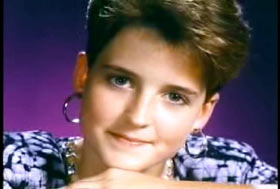 A young woman, Amy Bradley, with short hair and hoope earrings.