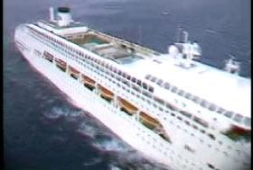 A white cruise ship out to sea.