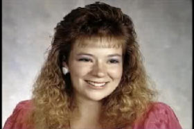 A young woman, Angela Hammond, with crimped blonde hair and pink dress.