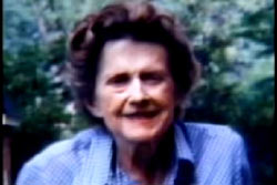 An elderly woman, Annie Laurie Hearin, with short curly hair and a blue shirt.
