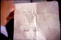 A typed letter, the kidnapper's note is being held up, though it is ineligible.