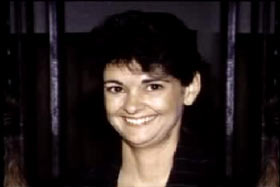 A middle aged woman with short curly black, Latricia White.