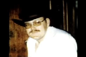 Lee 'Dub' Wackerhagen wearing a white shirt and cowboy hat.