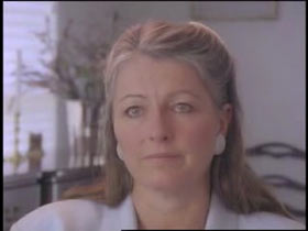A middle aged woman, Denise Allen, with gray hair partially put up.