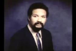 An african american man, Charles Southern, in a suit with a mustache and goatee.
