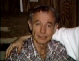 An elderly caucasian man with short grey hair wearing a grey plaid shirt, Dale Kerstetter.