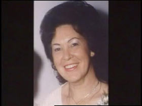 A middle aged caucasian woman with short black hair, Jean Moore.