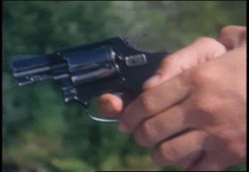 Two hands gripping a small pistol.