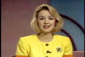 A caucasian female news anchor wearing a yellow dress and has shoulder length blonde hair, Jodi Huisentruit.