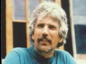 An elderly caucasian man with short grey hair and a patchy beard, Keith Reinhard.