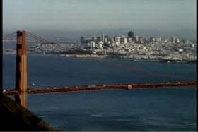 The golden gate bridge with the skyline of San Francisco in the background.