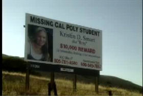 A billboard advertising a reward for information on Kristin Smart's whereabouts.