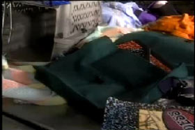 A closer look at the personal belongings in the back seat, including shoes, clothes and books.