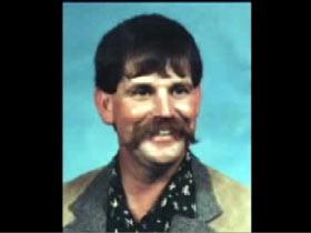 A colored headshot of Lenny Dirickson
