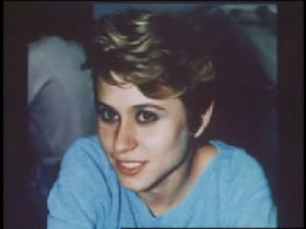 A caucasian woman with short blonde hair and a blue sweater, Lisa Bishop.