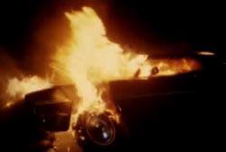 A car engulfed in flames.