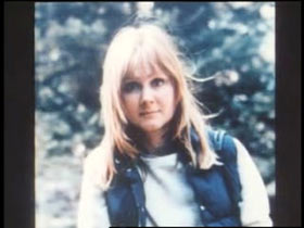A middle aged woman, Patricia Meehan, with shoulder length brown hair and bangs.