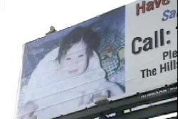 A billboard advertising that Sabrina is missing and a number to call.