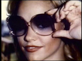 Tami Lynn Leppert posing with large sunglasses.