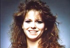 A young woman, Tara Breckenridge, with long brown hair.