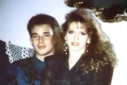 Tara Breckenridge is sitting on her boyfriend's lap, Wayne. He is a caucasian man with short brown hair