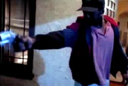 Suspect in a hat aims his gun at someone