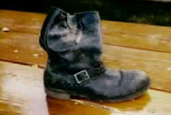Tom's worn leather boot