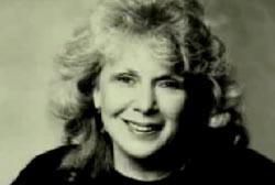 An elderly woman with blonde hair, Anita Green.