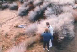 Two people stumbling across the lifeless body of Don Smith off the side of a road