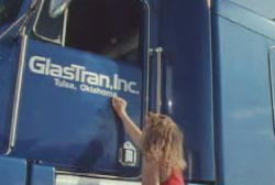 A woman Knocking on the driver side door of a semi truck
