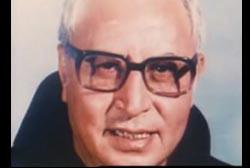Smiling Fr. Reynaldo Rivera wearing glasses