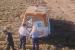 Paramedics putting the covered body of Reynaldo into the back of an ambulance