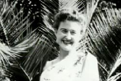 Smiling Jean Ellroy in frony of palm trees