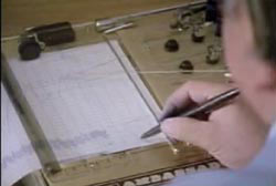 A man using a pen to analyse a lie detector test