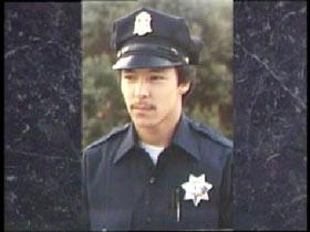 Smiling Lester Garnier in police uniform