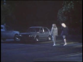 Two women walking towards a car in a parking lot