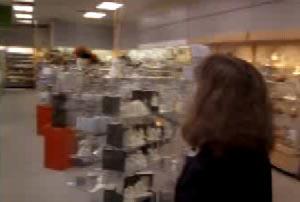 Lisa's coworker walking into an empty store