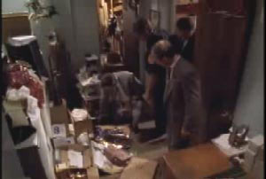 Investigators examining the back room of a store